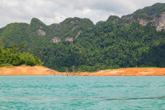 Beautiful mountains lake and natural attractions in Ratchaprapha Dam at Khao Sok National Park. Thailand Royalty Free Stock Photo
