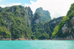 Beautiful mountains lake and natural attractions in Ratchaprapha Dam at Khao Sok National Park. Thailand Stock Photo