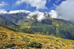 Fagaras Mountains in Romania. Scenic view of Fagaras mountains with blue sky and cloudscape background, Romania royalty free stock photos