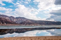 The beautiful mountains landscape with lake and reflection. Stock Photo