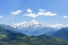 Beautiful mountains landscape on sunny clear summer day. Georgian nature. Hills and mountain snowy peak royalty free stock photography
