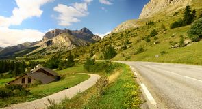 Wonderful mountains over beautiful alpine road on a sunny day, Briancon, France royalty free stock photos