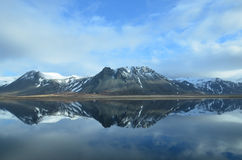 Beautiful Mountains Reflecting in the Water. Iceland`s mountains reflecting in water Royalty Free Stock Images