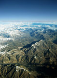 Beautiful mountains from the sky. Aerial View of the Himalaya Range on a clear day, flight New Delhi to Leh Stock Photo
