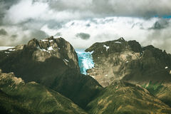 Beautiful mountains. Beautiful snow-capped mountains against the white fog in Antarctica royalty free stock images