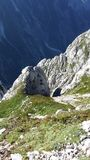 BEAUTIFUL MOUNTAINS. VIEW OF THE VALLEY ON THE WAY TO MOUNT MANGART SLOVENIA stock photography