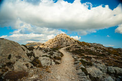 Beautiful mountains on the western part of Mallorca island, Spai. Beautiful landscape with a lane between rocky mountains on the western part of Mallorca island Stock Photos