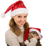 Beautiful mrs. Santa with lovely kitten. Beautiful Christmas girl with a lovely Christmas Kitten royalty free stock photo