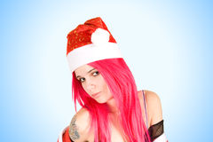Beautiful Mrs. Santa in red hat stock images