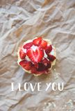 Beautiful muffin with fresh strawberries lies on the craft paper, the inscription I love you Royalty Free Stock Image