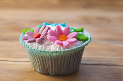 Beautiful muffins decorated with spring flower Royalty Free Stock Image