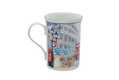 A beautiful mug made of collectors quality porcelain and decorated with floral patterns and the illustration. A perfect piece of kitchenware for the Stock Photo