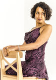 Beautiful mulatto girl in a bright dress Royalty Free Stock Photography