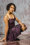 Beautiful mulatto girl in a bright dress Stock Images