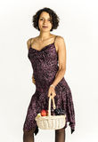 Beautiful mulatto girl in a bright dress with a basket of fruit Royalty Free Stock Photography