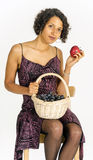 Beautiful mulatto girl in a bright dress with a basket of fruit Royalty Free Stock Photos