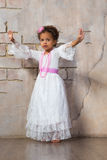 Beautiful mulatto girl dancing in a white dress Stock Photo