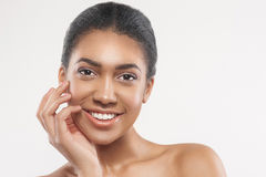 Beautiful mulatto girl enjoying skincare treatment Royalty Free Stock Photos
