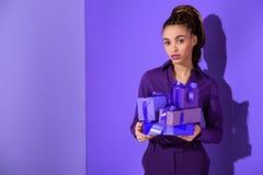 beautiful mulatto girl holding purple presents, ultra violet Stock Photography