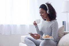 Beautiful mulatto girl is resting at home Royalty Free Stock Photo
