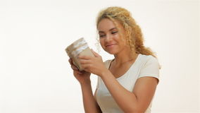 Beautiful mulatto girl shaking a gift present stock footage
