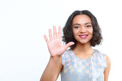 Beautiful mulatto girl standing with palm up Stock Images