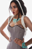 Beautiful mulatto in lingerie corset ropes and blue corral Stock Images
