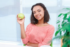 Beautiful mulatto woman holding apple Royalty Free Stock Photos