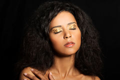 Beautiful mulatto woman with tiger make up. Royalty Free Stock Photography