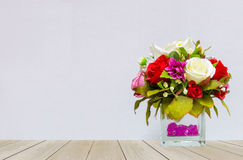 Beautiful Multi Color of Roses in Glass Flowerpot at The Corner on Wooden Table with Gray Background. With Copyspace for Mock up to Display Product or input Stock Photos