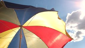 Beautiful multi-colored beach umbrella. stock video