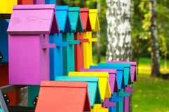 Beautiful multi-colored birdhouses in the Park. High-rise birdhouse Royalty Free Stock Images