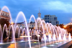 Beautiful multi-colored fountain in the city Dnepr at night (Dnepropetrovsk), Ukraine. Beautiful multi-colored fountain near the Opera House in the city Dnepr at stock photography