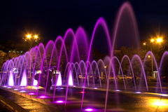Beautiful multi-colored fountain in the city Dnepr at night (Dnepropetrovsk), Ukraine,. Beautiful multi-colored fountain near the Opera House in the city Dnepr royalty free stock photos