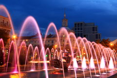 Beautiful multi-colored fountain  in the city Dnepr at night (Dnepropetrovsk), Ukraine. Stock Photos