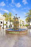 Beautiful and multi-colored fountain in a square Royalty Free Stock Photo