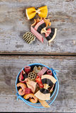 Beautiful multi-colored pasta in a blue bucket. royalty free stock image