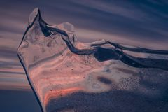 Beautiful multi-colored winter ice at sunset stock images