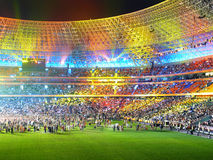 Beautiful multi-coloured arena. Under beams of projectors stock photography