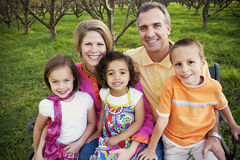 Beautiful Multi-racial Family. A portrait of a happy beautiful family with multi-racial children stock images