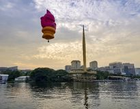 The beautiful of multi shaped of hot air balloons floating over sunrise skies at the 10th Putrajaya International Hot Air Balloon. PUTRAJAYA, MALAYSIA - MARCH 29 royalty free stock photos