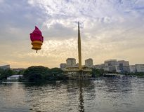 The beautiful of multi shaped of hot air balloons floating over sunrise skies at the 10th Putrajaya International Hot Air Balloon. PUTRAJAYA, MALAYSIA - MARCH 29 stock photos
