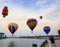 The beautiful of multi shaped of hot air balloons floating over sunrise skies at the 10th Putrajaya International Hot Air Balloon. PUTRAJAYA, MALAYSIA - MARCH 29 stock photography