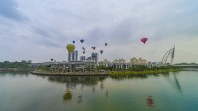 The beautiful of multi shaped of hot air balloons floating over sunrise skies at the 10th Putrajaya International Hot Air Balloon. PUTRAJAYA, MALAYSIA - MARCH 29 royalty free stock image