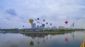 The beautiful of multi shaped of hot air balloons floating over sunrise skies at the 10th Putrajaya International Hot Air Balloon. PUTRAJAYA, MALAYSIA - MARCH 29 royalty free stock images