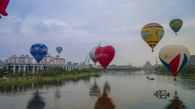 The beautiful of multi shaped of hot air balloons floating over sunrise skies at the 10th Putrajaya International Hot Air Balloon. PUTRAJAYA, MALAYSIA - MARCH 29 stock photo