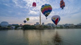 The beautiful of multi shaped of hot air balloons floating over sunrise skies at the 10th Putrajaya International Hot Air Balloon. PUTRAJAYA, MALAYSIA - MARCH 29 stock images