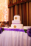 Beautiful multi-tiered wedding cake with purple tones Stock Image