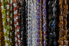 Beautiful multicolor beads in necklace form, marvelous colorful beads in necklace form as background, texture. stock photography