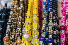 Beautiful multicolor beads in necklace form, marvelous colorful beads in necklace form as background, texture. stock image